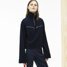 Crafted in flowing wool crêpe, this Fashion Show zip turtleneck top hot off the press features pockets and flared sleeves for an ultra-feminine effect.