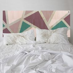 In bloom. This KALEIDA headboard has been thoughtfully designed, balancing a kaleidoscope of fashionable colours. Strips of natural wood are