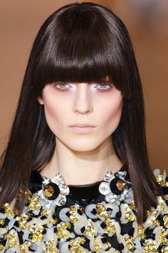 Trend: Blunt Bangs    Straight-across fringe added an edge to hairstyles at Marni (shown here), Antonio Berardi, Versace, and Elie Saab.