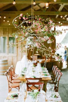 Whimsical wedding decor idea - hanging floral and branch reception decor {Highland Avenue]