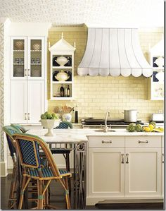 hood a bit too cute for me, but love the details on the flanking wall cabinets, iron on the island table...
