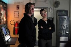 """All Hands on Deck in """"Squall"""" Episode 19 of Season 10   A massive storm brings the NCIS team aboard the USS Borealis, where everyone becomes a suspect once the crime scene proves that Mother Nature wasn't the only culprit, on NCIS, Tuesday, March 26 (8:00-9:00 PM, ET/PT) on the CBS Television Network. Also Pictured left to right: Joel Gretsch and Cote de Pablo Photo: Sonja Flemming/CBS ©2013 CBS Broadcasting, Inc. All Rights Reserved."""
