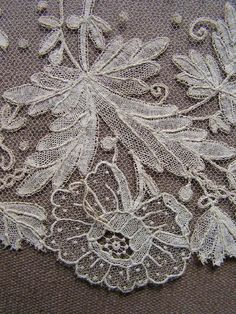 Brussels bobbin and needlelace applique on machine net.