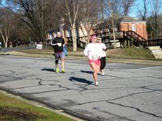 Runners run down Jackson Street Extension during the Roanoke Canal Half-Marathon/8K.