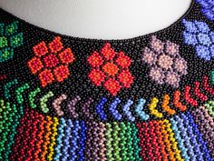 The beautiful Pavo Real necklace is handmade by the women of the La Mega cooperative in Ecuador. This piece is named after a peacock, but the design represents the sacred matizado pattern; a color-ble Native Beadwork, Native American Beadwork, Seed Bead Art, Beaded Choker, Beaded Jewellery, Beaded Jewelry Patterns, Seed Bead Necklace, Peyote Patterns, African Jewelry