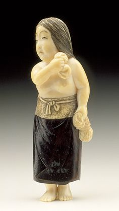 Netsuke, Diving Girl ,Ivory with sumi, wood and metal inlay.late 19th-early 20th century , collection Raymond and Francis Bushell