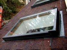 Calgary Skylights - Calgary Skylight Repair and Replacement www.skylightscalgary.com 1.403.873.7663 | The head flashing is on the right side of this photo. It extends up another 7 inches under the shingles farther up the roof.