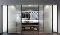 Picà   Azure Product Guide -- This walk-in closet comes with sliding glass doors layered in fabric and panelling lined in Cretto cashmere, applied through a pressing process. The system's elements are made of thermo-structured melamine that meets stringent targets for low-formaldehyde emissions.