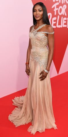 Naomi Campbell attended the Fashion for Relief event during the 70th annual Cannes Film festival, donning a stunning floor length gown with intricate crystal detailing. A sparkling cuff and metallic gold sandals completed the look.