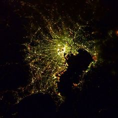 """Tokyo!!"" #AstroButch  Photo Credit Barry Wilmore: 131B0588  #nasa #nasajsc #spacestation #internationalspacestation #explore #exploration #photography #ISS #Exp42 #cupola #geography #EarthArt #Japan #green #lights #brilliant #city #night #bold #orange"