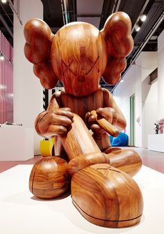 'karimoku wood companion' by KAWS at 'this is not a toy' co-curated by pharrell at the design exchange