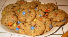 Amish Monster Cookies      //       The Amish bakery I went to in Holmes County added raisins, nuts, maybe craisins.      //  The cookies were large,      //      It elevated the cookie to a quick on-the-go breakfast.