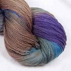 Lace - Philippines - Intrepid Tulips Yarn 100 grams, 1000 yards. $36  Dyes are washfast and lightfast..  Hand wash, dry flat.. Colors alternate between rich shades of woodsy brown, with navy, plum, forest green and a spark of teal.