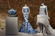 Jar with dragon, Roberto Cavalli evening dress, and Alexander McQueen by Sarah Burton evening dress
