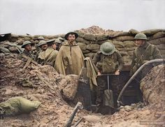 WW1. Soldiers of the Lancashire Fusiliers using a pump to drain a flooded front line trench. ©IWM Color by Laiz Kuczynski