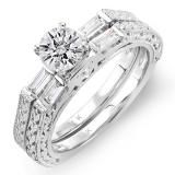 Simple is just not her style! Satisfy her craving for sparkle and shine with this brilliant bridal set. Fashioned in 14K white gold, this exquisite set features an engagement ring glittering with round and tapered baguette diamonds flanking an exceptional round center stone. The wedding band is also lined with shimmering diamonds, and the combined total for both rings is a full 0.83 ct.