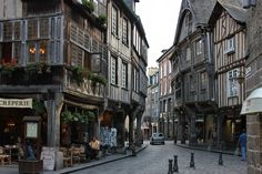 """Dinan, France is located near the famous and beautiful city of St. Malo in the region of Brittany. It has a fairy tale quality to it, perfect for a romantic short holiday. The typical (regional) food is the Crêpe, which includes the salty """"Galettes"""" kind, and the sweet kind. The locals typically pair the crepes with local French cider. The region also specializes in Caramel (for sweet lovers). The whole town can be seen by foot, and every corner hides incredible beauty."""