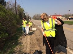 Volunteers from Channel 10/11 KOLN-TV clean up litter along West Van Dorn Street in Lincoln, NE as part of the Great American Cleanup through Keep Lincoln and Lancaster County Beautiful.