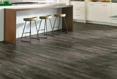 Armstrong 'Luxe' Plank Luxury Vinyl Flooring:  Remarkably realistic wood and stone designs.  Quick and easy installation, in multiple options.  100% waterproof.