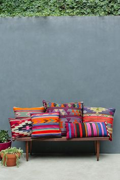 My Attic woven throws bright colors, kilims in the garden grey wall pinned by barefootstyling.com