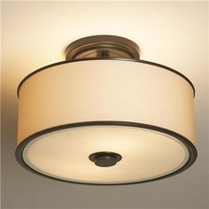 Urban Loft Ceiling Light:  This minimalist ceiling light offers a sleek, urban style with its cream organza drum shade, contrasted by dark Bronze or brushed Nickel metal bands and a bottom diffuser for a soft glow of light.