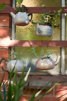 Love this idea for old garage sale tea pots and kettles.