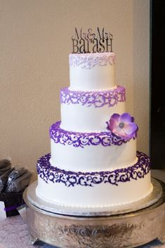 Purple ombre wedding cake with Mr. and Mrs. cake topper // George Street Photo & Video // http://www.theknot.com/submit-your-wedding/photo/b911ca13-fbd8-4d06-8d17-92f3ef42b8f2/Monique-and-Yonathans-Wedding