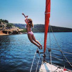 Ionian Flotilla Sailing - Girl jumping from the boat