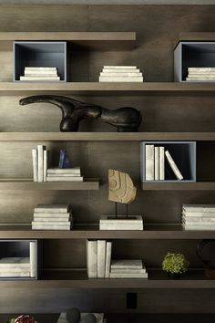 Emma, I'd like to see more spacing between the shelves around your tv, but I like the way these are a bit random and how they end.  CR CORONADO CONTEMPORARY | Jeffrey Alan Marks