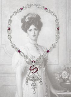 FORMERLY THE PROPERTY OF ANITA DELGADO, FIFTH WIFE OF MAHARAJA JAGATJIT SINGH OF KAPURTHALA - AN EARLY 20TH CENTURY DIAMOND AND RUBY PENDENT NECKLACE The Belle Epoque pendant designed as a stylised basket of flowers with diamond collet and floral drops to the calibré-cut ruby ribbon and diamond winged surmount, suspended from a later Art Deco diamond-link necklace with oval-cut ruby spacers, pendant circa 1905, necklace circa 1925, 45.0 cm long. Price Realized $123,541 Est. $81,680…
