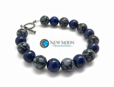 Awareness, Power, Balance, Calming, and Grounding Bracelet Listing is for one bracelet made with 8mm Lapis Lazuli and Snowflake Obsidian Bead. Size is custom, so please measure your wrist and select your size. Metaphysical Properties: Snowflake Obsidian: A stone of purity, Snowflake Obsidian brings about a balance to body, mind and spirit. Snowflake Obsidian helps to keep centered and focused when any type of chaotic situation (office, commute, home, etc.) presents itself. Snowflake Obsidian can Healing Stones, Crystal Healing, Memorial Stones, Snowflake Obsidian, Crystal Bracelets, Bracelet Sizes, Semi Precious Gemstones, Lapis Lazuli, Bracelet Making