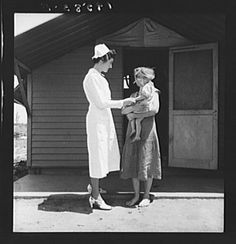 Farm Security Administration (FSA) camp. Farmersville, Tulare County, California. Shows resident nurse come to visit family where there is a sick baby. 1939