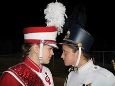Cousins and best friends Natalie Fowler, left, and Ashton Wilbur engage in a stare down in anticipation of the 100th meeting between the Wellston Golden Rockets and Jackson Ironmen. The girls play the flute for their respective marching bands. (Photo by Melanie Durham)