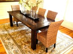 Farmhouse Table and with Drinks Cabinet Recessed Lights Painted Wood Flooring Stainless Range Hood