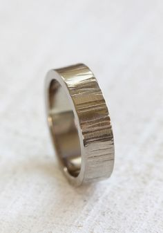 Wide 14k Gold Tree bark wedding ring. This solid 14k gold wedding band has a wood grain pattern. The men's wedding ring is organic and completely random pattern makes each ring unique and one of a kin