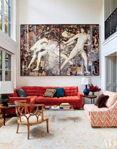 A Vik Muniz diptych presides over a sitting room in a New York home by Robert A.M. Stern Architects. A Dune sectional sofa sits atop a carpet from FJ Hakimian | archdigest.com