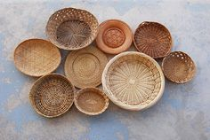 Set of 9 vintage baskets. They are a beautiful mix of different materials (bamboo, wicker, ratan, straw) and weaves, but they are all on the light end of the spectrum. I intentionally chose baskets that arent deep and have a low profile so that they can be hung in a high traffic area