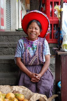 A Tzutihil woman from Santiago de Atítlan en Guatemala...Her hat is a long, long, long piece of red fabric wound tight around her head.  Amazing.