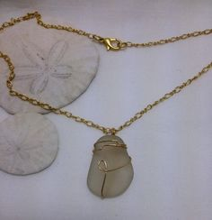 Frosted white sea glass pendant wrapped in 12Kt gold wire - handmade, recycled, eco-friendly #handmade #silverjewelry
