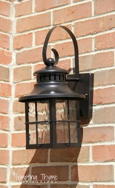How to paint light fixtures without removing them home craft cleaning up the outside of our house by spray painting the light fixtures flanking our garage workwithnaturefo
