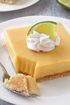 Key lime pie bars with a thick, creamy filling and a coconut cookie crust.