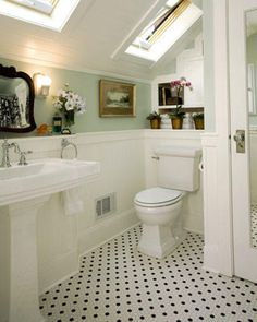 beautiful sea glass green with white.  Love the touches like the oil painting, daisies and antique mirror and love the old fashioned black and white tile floor.