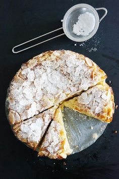 Lemon Ricotta and Almond Flourless Cake. 120 grams unsalted butter, 1 cup caster sugar, 1 vanilla bean, split and seeds scraped, 1/4 cup lemon zest, 4 eggs, separated, 2 1/2 cups almond meal, 300 grams ricotta.