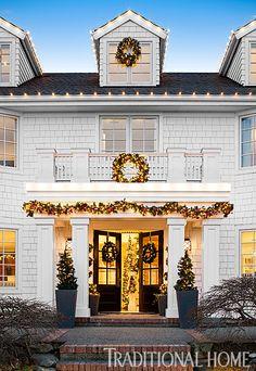 Abundant greenery and Christmas lights illuminate this seattle home for the holidays. - Photo: John Granen