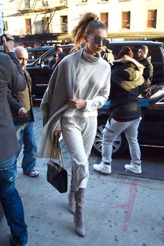 "Gigi Hadid's Secret To Athleisure Is Easier Than You Think #refinery29  http://www.refinery29.com/2016/01/102185/gigi-hadid-style-pictures#slide-6  This coat brings new meaning (and gravity) to ""off-the-shoulder.""..."