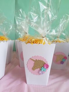 These versatile unicorn theme Mini popcorn boxes can be filled with candies, popcorn and others treats while dressing up your table !... You Can Choose Quantity !! MEASURE : 2 1/2 in x 5 1/4 in x 1 1/2 in. IT FOOD SAFE. The Favor bags and other items are Not Including on This