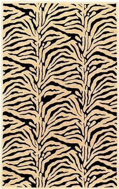 Beau Faux Zebra Rug -- Classic animal prints can be the perfect versatile, bold pattern to accent neutral colored living room furniture. | cort.com