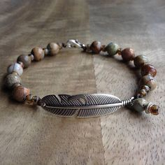 This beaded gemstone bracelet is made with, Impression jasper beads , Miyuki beads, a metal lobster clasp and a metal feather charm. Fits a wrist of 18 cm = 7.08 inch. Please read my policies before ordering.