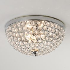 Could take a plan flush mount bowl and glue flat back glass stones! Crystal Jewel Ceiling Light Chrome circles frame hundreds of cut crystal jewels in this flush mount ceiling light producing intimate reflections on the ceiling and walls. Moroccan Ceiling Light, Ceiling Light Shades, Semi Flush Ceiling Lights, Flush Mount Ceiling, Flush Mount Lighting, Ceiling Light Fixtures, Lighting Shades, Closet Lighting, Hallway Lighting