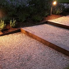 Oak sleepers and Everedge metal edging contain the Breedon gravel all illuminated by Hunza lights. Designed by Anthony Paul and constructed by Bushy Business Gardens. Metal Landscape Edging, Metal Garden Edging, Lawn Edging, Garden Paths, Landscape Design, Sleepers In Garden, Oak Sleepers, Garden Stairs, Back Gardens